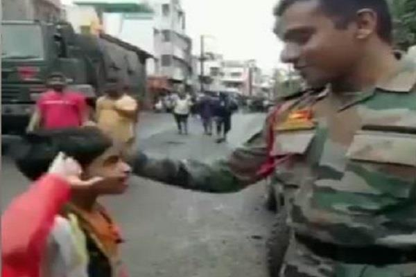child saluted the young man and said you do a great job