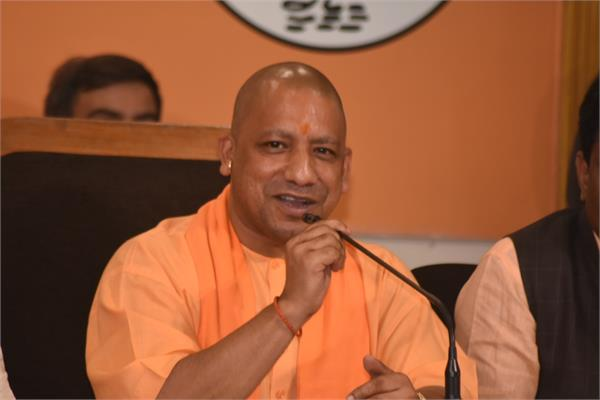 cm yogi adityanath distributes districts among ministers