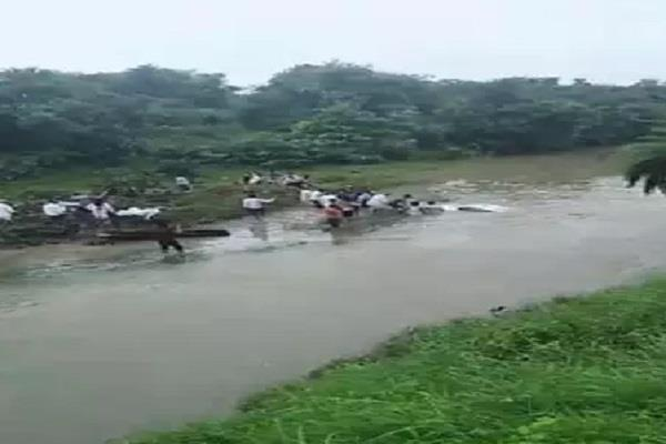 three people including a car were washed away in a swollen drain