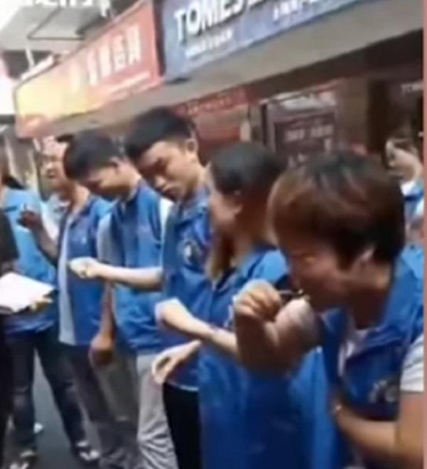 chinese workers forced to eat live fish and drink chicken blood