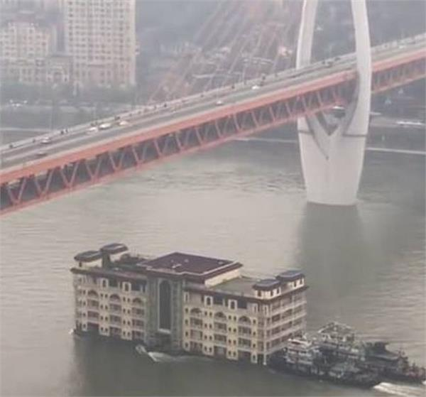 five storey building caught floating across china river in viral video