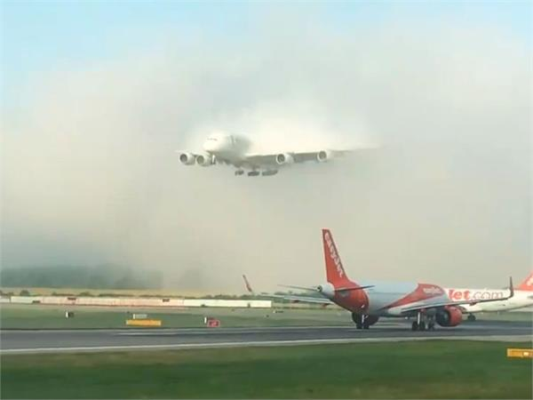 watch aircraft s grand entrance through clouds is viral