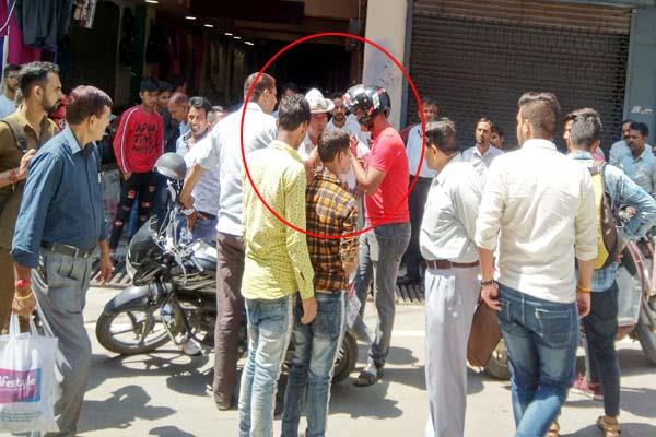 broke rule first then bike rider got entangled with traffic police