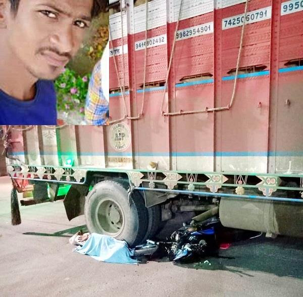 collision between truck and motorcycle