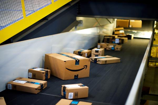 amazon to partner with grocery stores to fight reliance jio