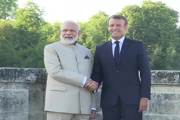 pm modi arrives in france meets president emmanuel macron