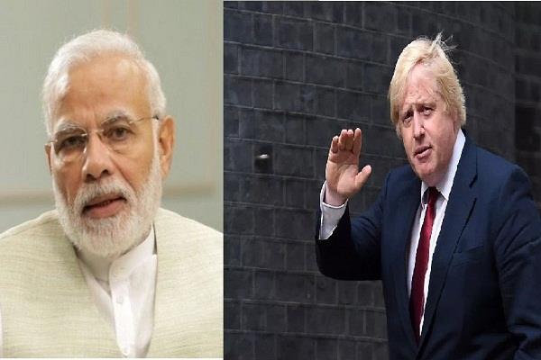 narendra modi talks to uk pm boris johnson raises issue of indian embassy