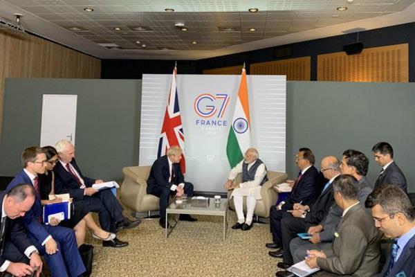 modi meets uk prime minister johnson in france