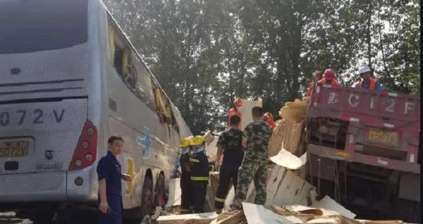 at least 36 killed in china after bus crashes with truck