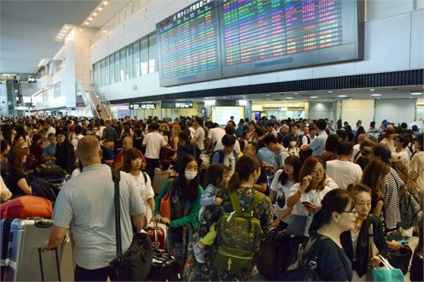 typhoon stranded 17 000 at tokyo airport