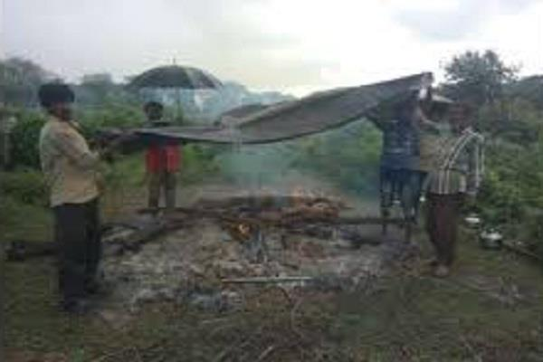 villagers forced to perform tarpaulin in the rain