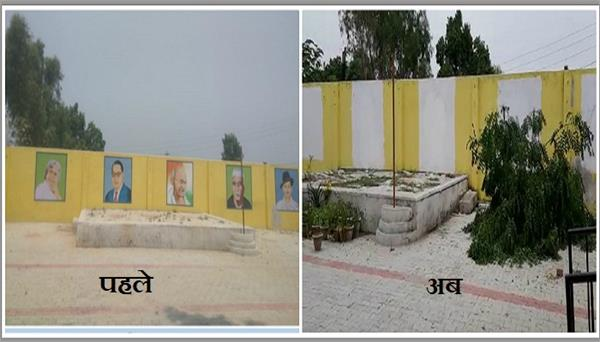 painted soot on the paintings of great men on the wall of the school s
