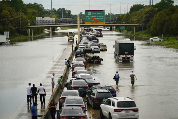 heavy rain brings houston to a halt ahead of mega  howdy modi