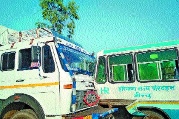 a bus coming at a high speed crushed the auto driver