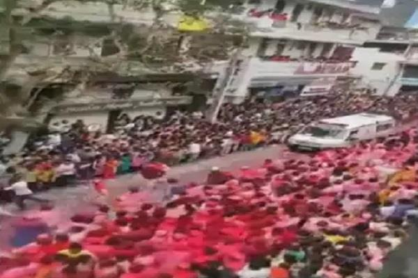 devotees give way to ambulance during ganesh idol immersion procession
