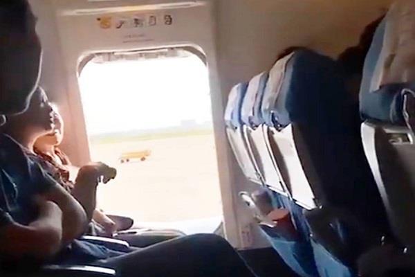 passenger opens plane emergency door
