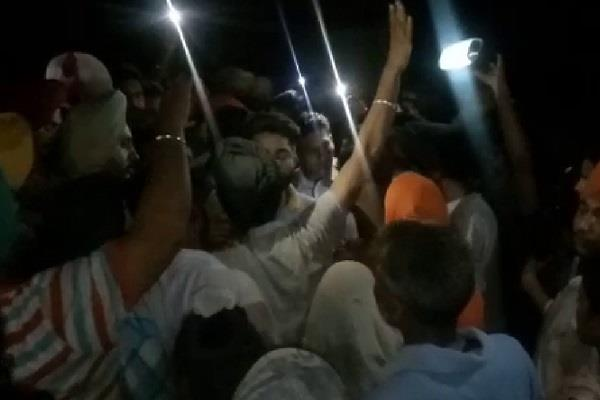 villagers and police meet face to face atmosphere tense