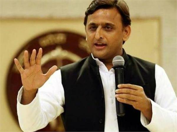 akhilesh was speaking on the stage water proof tents burst