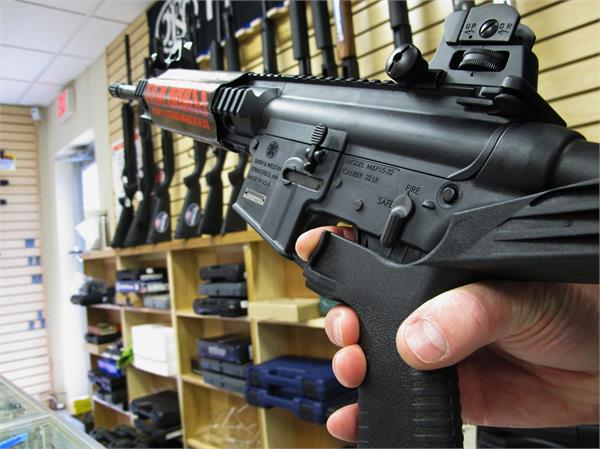 us houston man is first to be charged under bump stock ban