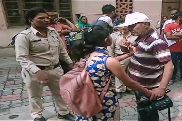 cameraman woman beaten video viral