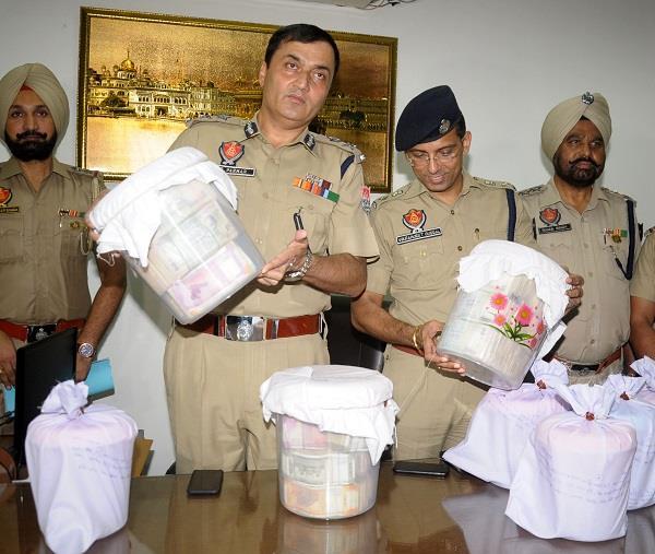 smuggler arrested with heroin drug money