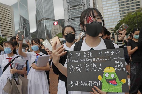 students boycott classes in hong kong china warns