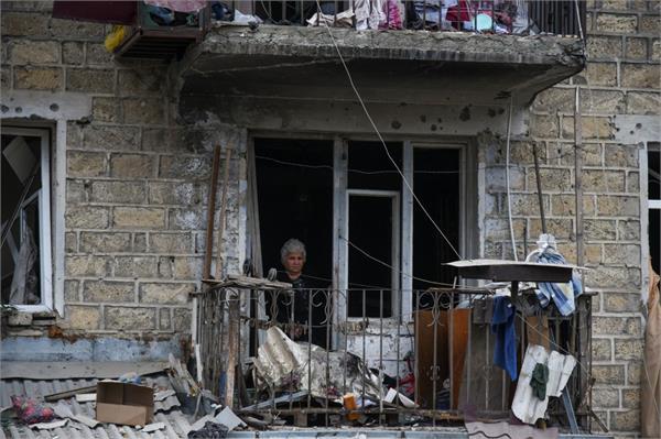 azeris and armenians say civilian areas attacked nato seeks ceasefire