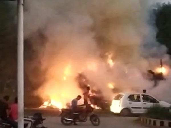 fire spread in front of petrol pump stroller filled with straw burnt to ashes