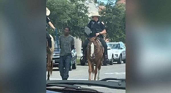 black man suing 1 million dollar after he was tied to police on horseback