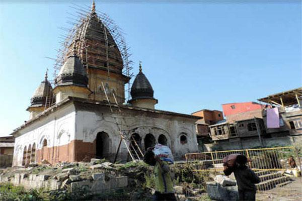 the work of repairing historic raghunath temple of srinagar in full swing