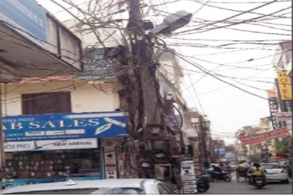 electric wires hanging on poles inviting accidents