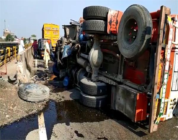 oil filled tanker overturns