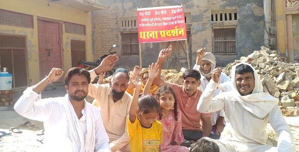 four families staged a protest in front of the former sarpanch s house