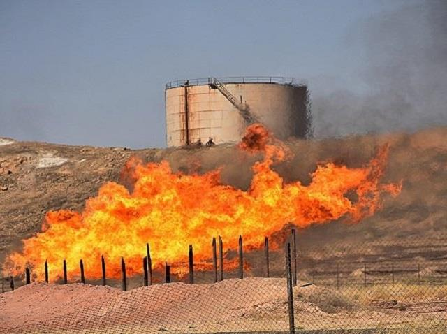 rocket attack causes large fire at an oil refinery in northern iraq