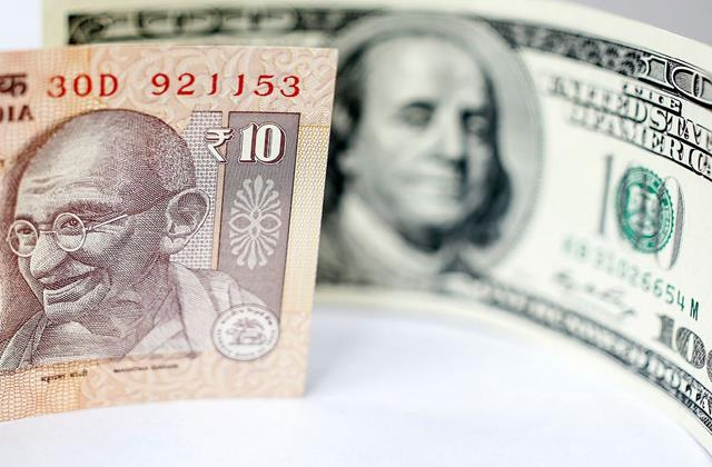 rupee gained 14 paise in early trade against dollar