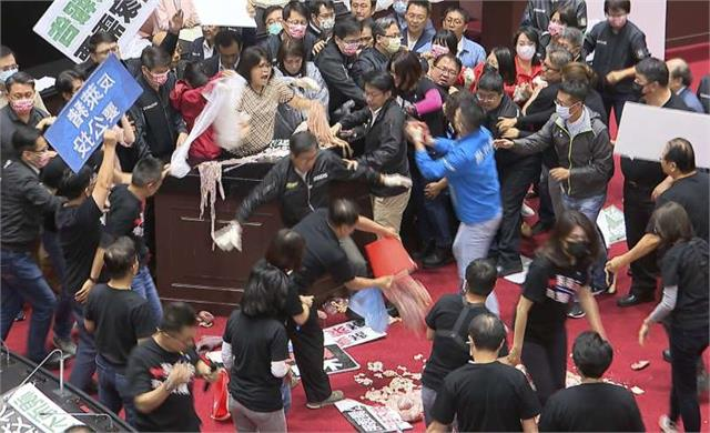 taiwan lawmakers throw pig guts in protest over meat imports