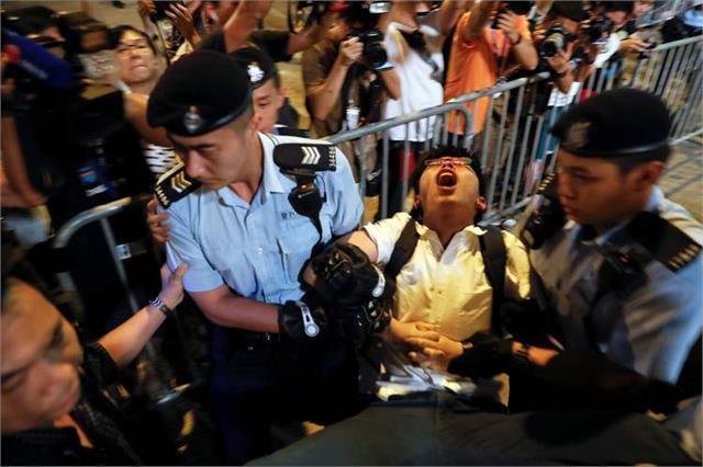 7 hong kong pro democracy activists arrested joshua wong