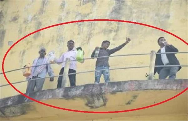 victims troubled family climbed on water tank carrying petrol