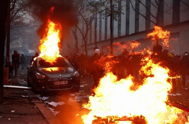 france violent clash between police and protesters fire in shops and cars