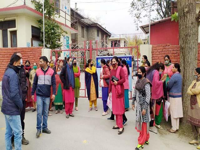 parent protest in out of school gate
