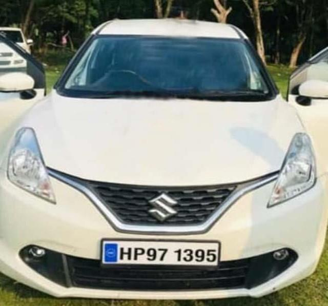 baleno car looted at the tip of a pistol accused absconding