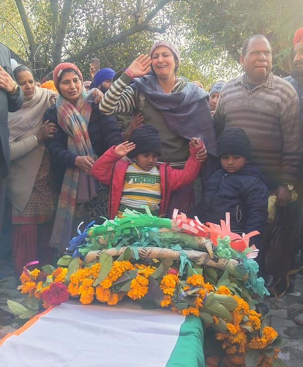every eye was moist when the martyr s wife and 4 year old twin sons saluted
