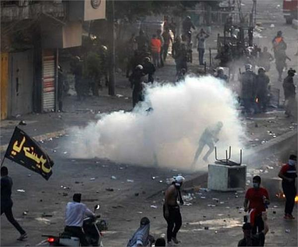 iraq s security forces kill at least two protesters in baghdad