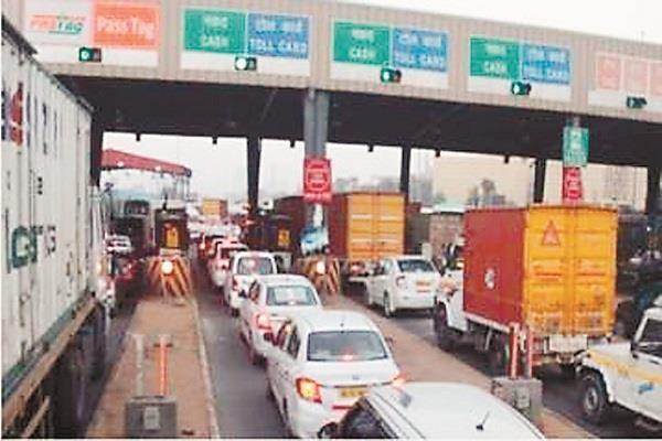 long line of vehicles on toll again vehicles seen crawling