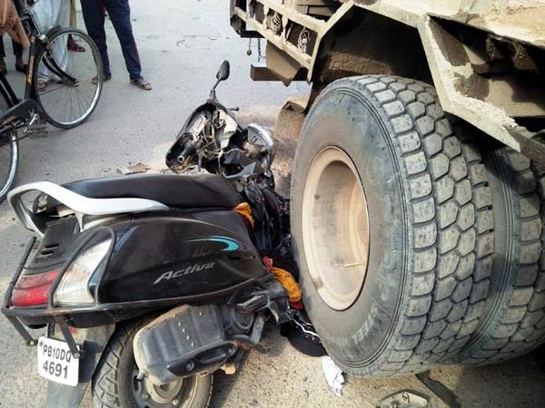 scooter riding woman came under tipper injured
