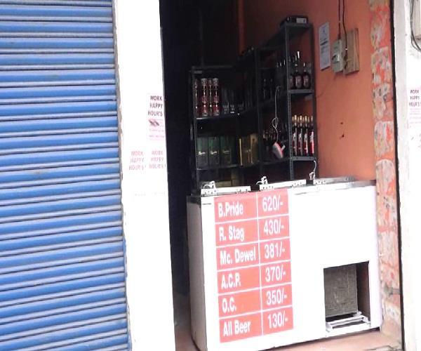 liquor store near temple and educational institute