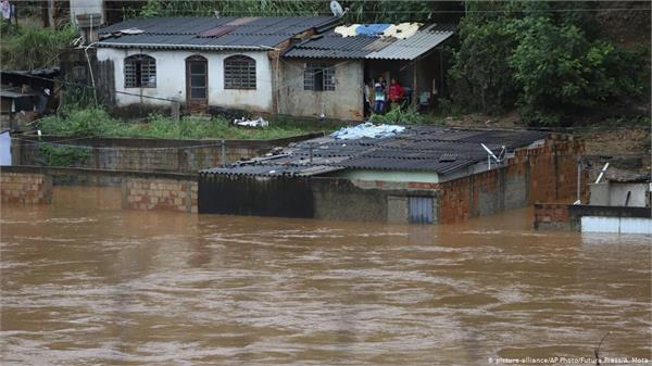 at least 52 dead after heavy flooding in brazil