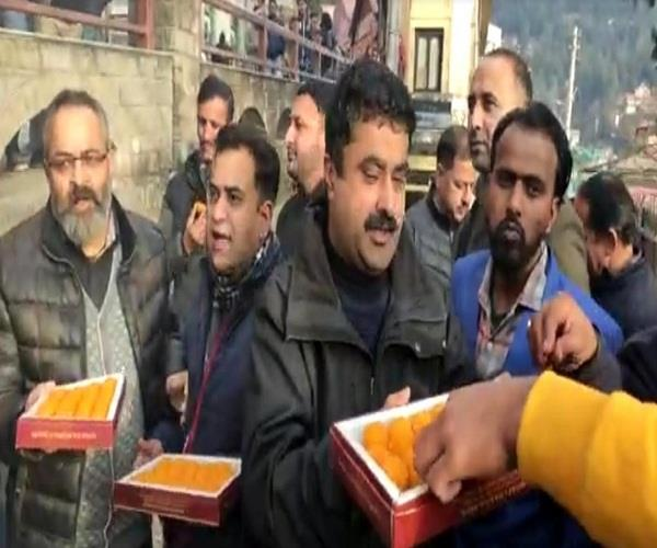 workers distributed laddus in shimla after becoming bjp president