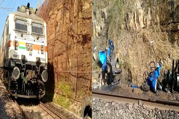 a tractor suddenly falls in front of the patalok train