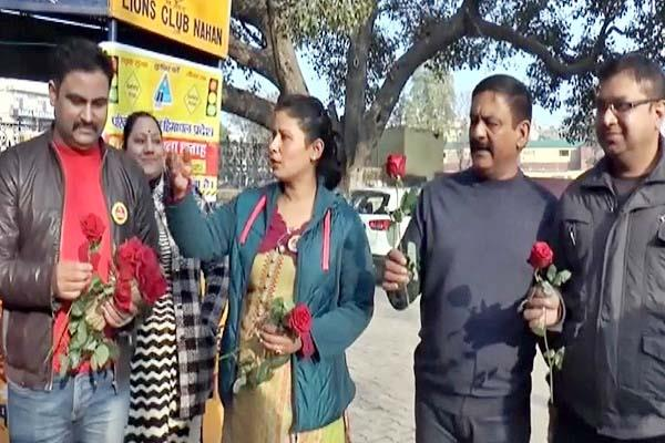 transport department distributing roses to people in nahan